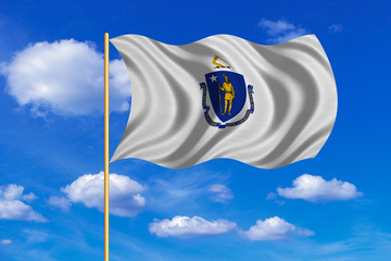 Flag of Massachusetts waving on blue sky backdrop