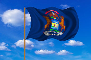 Flag of Michigan waving on blue sky background