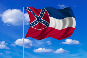 Flag of Mississippi waving on blue sky background