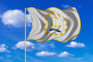 Flag of Rhode Island waving on blue sky background