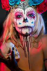 attractive young woman with sugar skull makeup