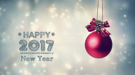 Happy New Year 2017 message with a hanging bauble