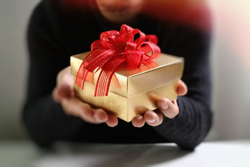 gift giving,man hand holding a gift box in a gesture of giving.b