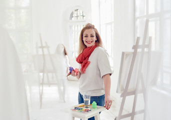 satisfied woman painter