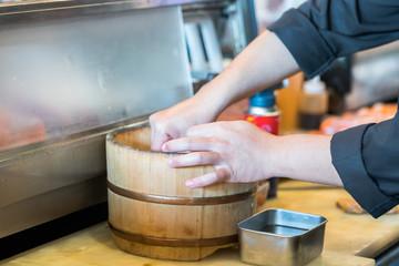 Japanese chef making salmon sushi - japanese food