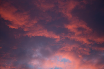 Dramatic and moody pink, purple, blue cloudy sunset sky