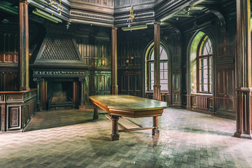 interior of Sharovsky Castle with table and fireplace