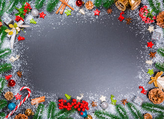 Christmas holiday background with snow fir tree, winter spices and decor. View with copy space