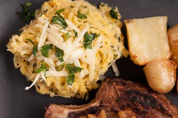 rib steak with squash, mushrooms and onion