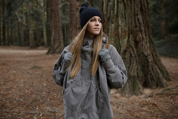 Young woman with backpack in forest
