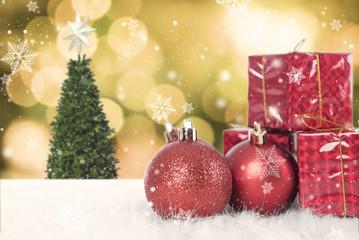Christmas balls with gift box and snowflake on christmas tree background.