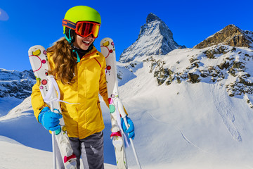 Teenage girl skiing in Swiss Alps in Sunny Day, Matterhorn in Ba