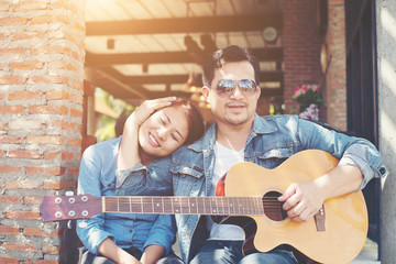 Hipster couple sitting relaxed with nice atmosphere with first d