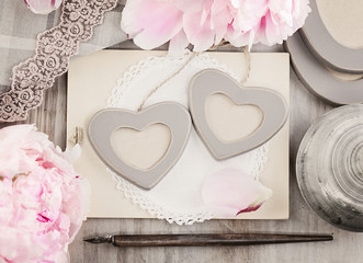 Two Hearts Photo Frames on Vintage Retro Background with Peony