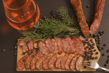 Tasty sausage, red beer and green juniper