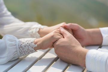 Groom Holding Hands of Bride