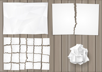 Set creasy and torn sheets of white paper on the background of the old board. Vector graphics