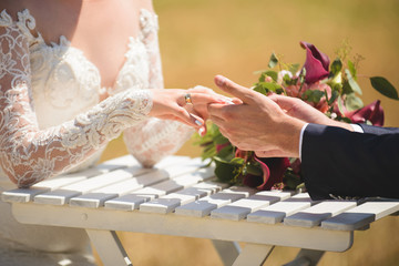 Couple Hands at Table with Bouquet