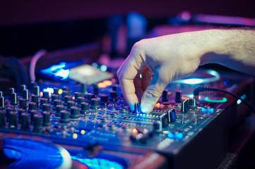 Obraz DJ playing music at mixer - fototapety do salonu