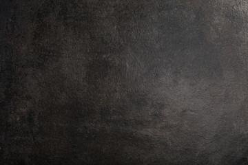 Overhead view of dark black stone surface