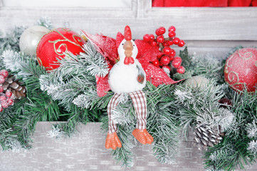 rooster, the symbol of the new 2017 years on the background of Christmas decorations