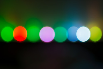 Background. Multi-colored lights of a Christmas garland in the background blurring