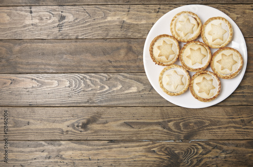 A plate full of freshly baked mince pies on a rustic wooden table top background with & A plate full of freshly baked mince pies on a rustic wooden table ...