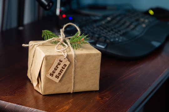 Present from secret santa on workplace. Office celebration concept