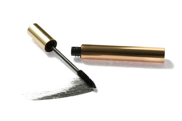 Black mascara brush with container on background