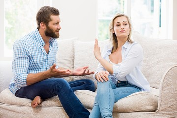 Upset couple arguing with each other