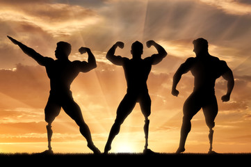 Paralympic bodybuilders with prosthetic leg sunset