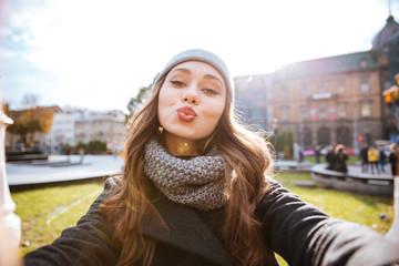 Girl in coat make selfie