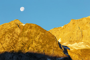Morning in a carstic mountain with a moon