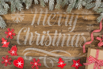 The inscription on Christmas with gifts and decorations on old w