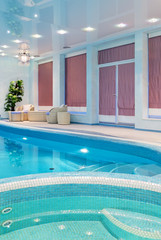 Relaxation zone near blue mosaic swimming pool