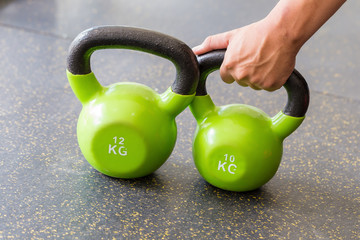 Green dumbbell On the floor.