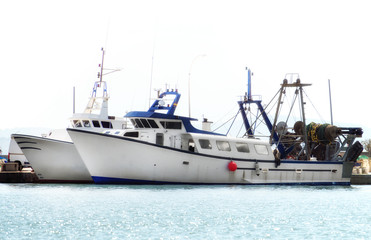 Two fishing vessels in the port.