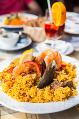 paella with seafood and meat