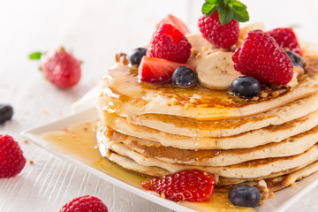 Pancakes with berries and maple syrup