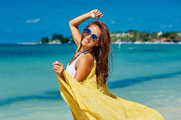 Beautiful girl having fun on the sunny beach