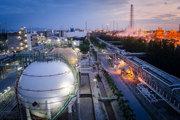 Gas storage sphere tank  petrochemical plant at dawn
