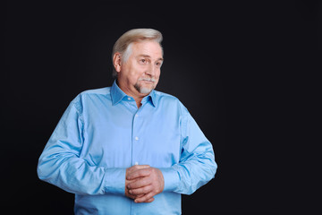 Positive delighted pensioner looking aside