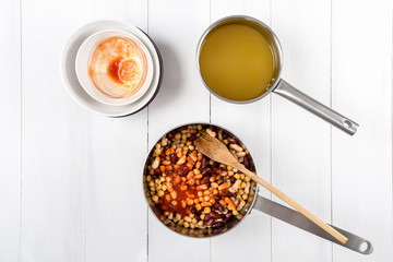 Preparing Chili Bean Stew On White Wood Kitchen Table
