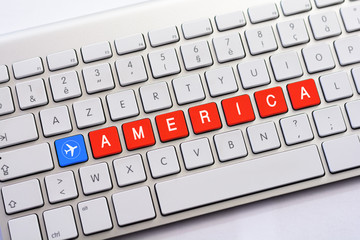 AMERICA writing on white keyboard with a aircraft sketch
