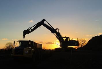 Excavator during sunset