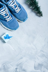 Christmas sport composition with shoes, and blue gift box