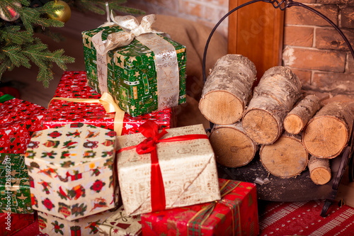 Christmas gifts under the tree. New Year home interior\