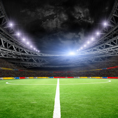 Soccer field with green grass and lights