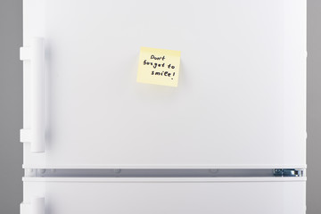 Don't forget to smile note on white refrigerator
