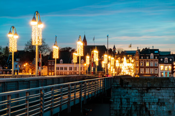 View at the Dutch Sint Servaas bridge with christmas lights in Maastricht